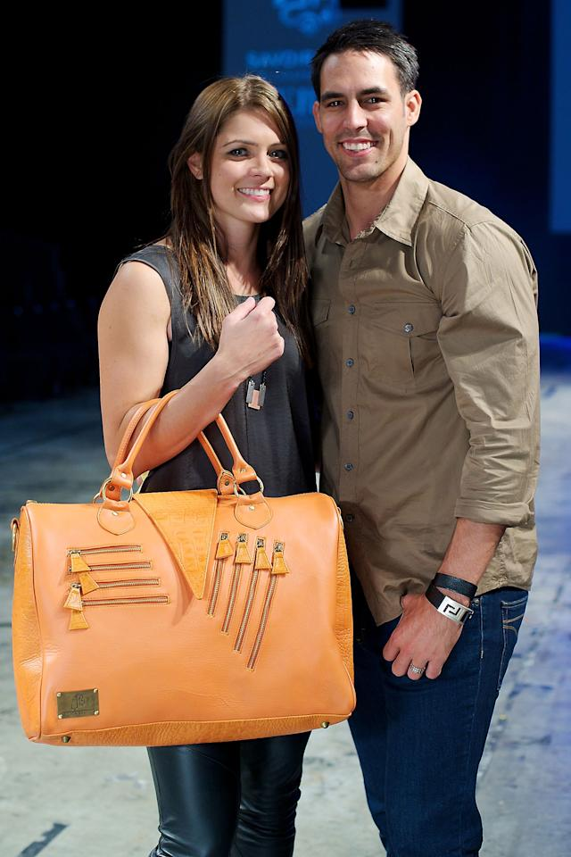 PERTH, WESTERN AUSTRALIA - APRIL 20:  Jessica Bratich and Mitchell Johnson front row at the Jessica Bratich showcase as part of the New Gen parade Perth Fashion Week 2012, at Perth Convention and Exhibition Centre on April 20, 2012 in Perth, Australia.  (Photo by Stefan Gosatti/Getty Images)