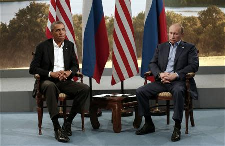 U.S. President Barack Obama (L) meets with Russian President Vladimir Putin during the G8 Summit at Lough Erne in Enniskillen, Northern Ireland, in this June 17, 2013 file photo. REUTERS/Kevin Lamarque/Files