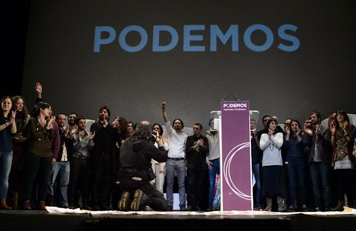 """Newly confirmed leader of Podemos, a left-wing party that emerged out of the """"Indignants"""" movement, Pablo Igesias (C) poses with supporters and party members in Madrid on November 15, 2014 (AFP Photo/Dani Pozo)"""