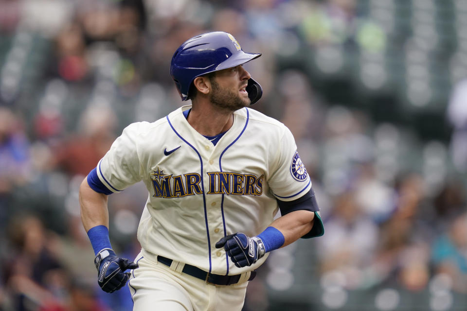 Seattle Mariners' Mitch Haniger watches the path of his solo home run against the Arizona Diamondbacks in the fourth inning of a baseball game Sunday, Sept. 12, 2021, in Seattle. (AP Photo/Elaine Thompson)