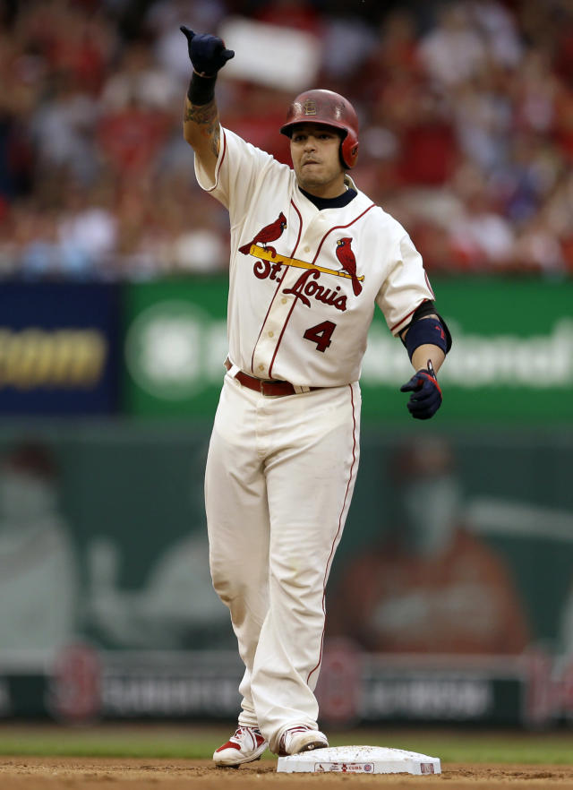 St. Louis Cardinals' Yadier Molina celebrates after hitting a two-run double during the third inning of a baseball game against the Chicago Cubs, Saturday, Sept. 28, 2013, in St. Louis. (AP Photo/Jeff Roberson)