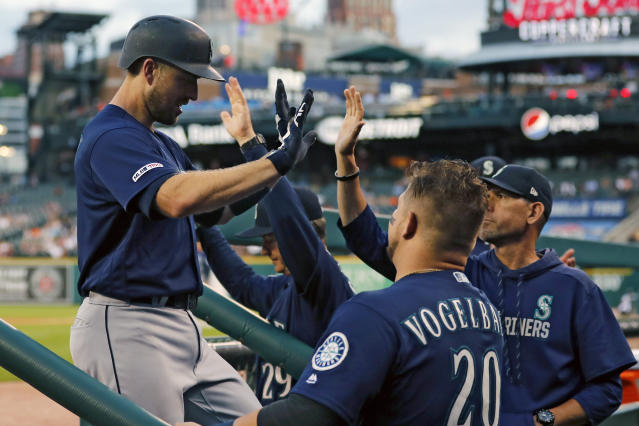 Seattle Mariners' Tom Murphy is greeted in the dugout after his solo home run during the fourth inning of a baseball game against the Detroit Tigers, Tuesday, Aug. 13, 2019, in Detroit. (AP Photo/Carlos Osorio)