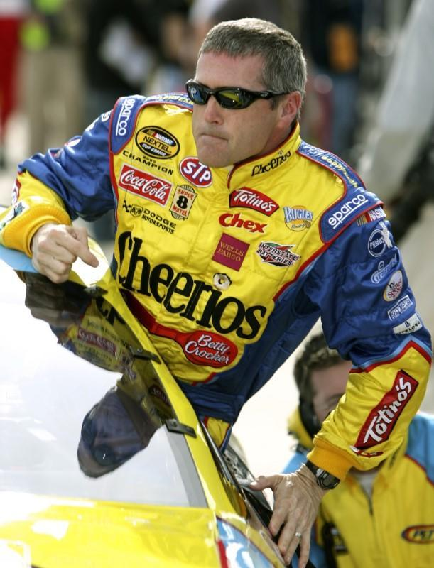 NASCAR Nextel Cup Series driver Labonte climbs out of his Cheerios Dodge after his qualifying attempt for the pole position for the 49th running of the Daytona 500 at the Daytona International Speedway