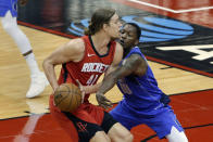 Houston Rockets forward Kelly Olynyk (41) avoids the reach in by Dallas Mavericks forward Dorian Finney-Smith (10) during the first half of an NBA basketball game Wednesday, April 7, 2021, in Houston. (AP Photo/Michael Wyke, Pool)