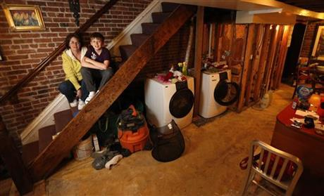 """<b class=""""credit"""">Julio Cortez/AP</b>In urban areas such as Hoboken, N.J., so-called """"basements"""" are active living spaces."""