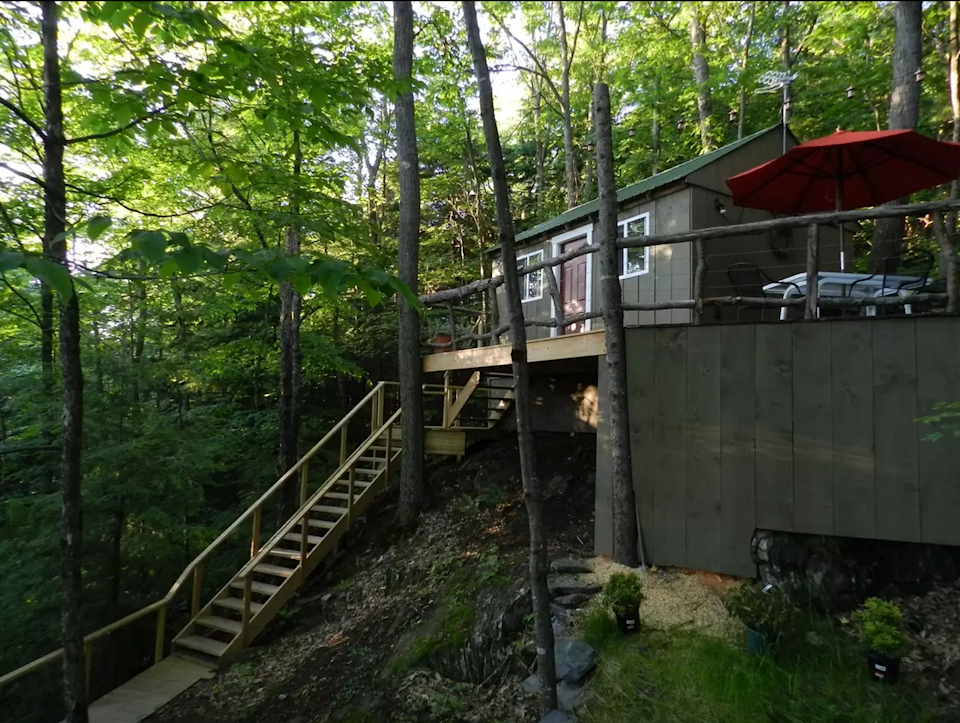 """<p>This <span class=""""redactor-unlink"""">tiny Vermont cabin</span> comes complete with modern amenities, including a custom-built cedar hot tub. The owners are treehouse enthusiasts, who have several available for rent nearby.</p><p><a class=""""link rapid-noclick-resp"""" href=""""https://www.airbnb.com/rooms/223318"""" rel=""""nofollow noopener"""" target=""""_blank"""" data-ylk=""""slk:BOOK NOW"""">BOOK NOW</a> <strong><em>Vermont Tree Cabin</em></strong><br></p>"""