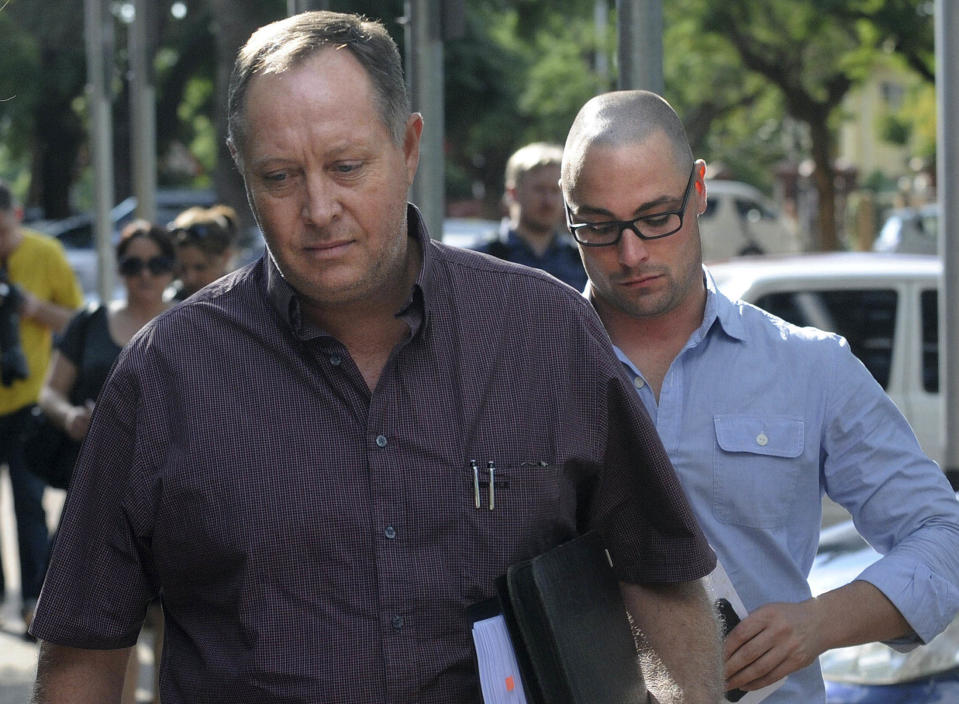 Kenny Oldwage, lawyer for Oscar Pistorius, foreground, and Carl Pistorius, brother of Oscar Pistorius arrive at the Brooklyn police station in Pretoria, South Africa, Sunday, Feb. 17, 2013. Oscar Pistorius faces a bail hearing Tuesday and Wednesday, in which prosecutors will have to offer a great explanation about why they've charged the Olympian with murder over the Valentine's Day shooting death of his model girlfriend Reeva Steenkamp. Pistorius hasn't entered a plea in the case, though his family has said they strongly deny the 26-year-old double-amputee runner committed murder. They have not, however, denied outright that Pistorius shot Steenkamp, a 29-year-old law school graduate now being featured in a South African reality television show. (AP Photo)