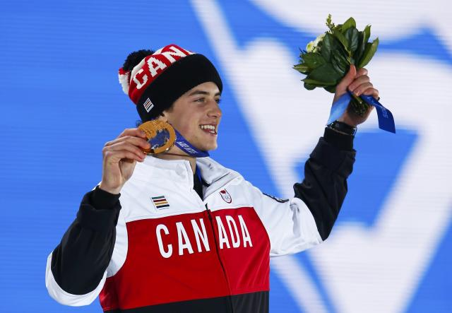 Bronze medalist Mark McMorris of Canada celebrates during the medal ceremony for the men's snowboard slopestyle competition in the Olympic Plaza at the 2014 Sochi Olympic Games February 8, 2014. REUTERS/Shamil Zhumatov (RUSSIA - Tags: OLYMPICS SPORT SNOWBOARDING)