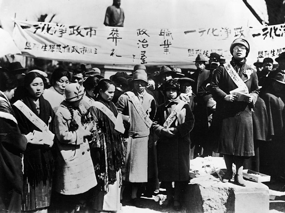 Japanese women hold a demonstration to protest low wages paid to female factory workers.