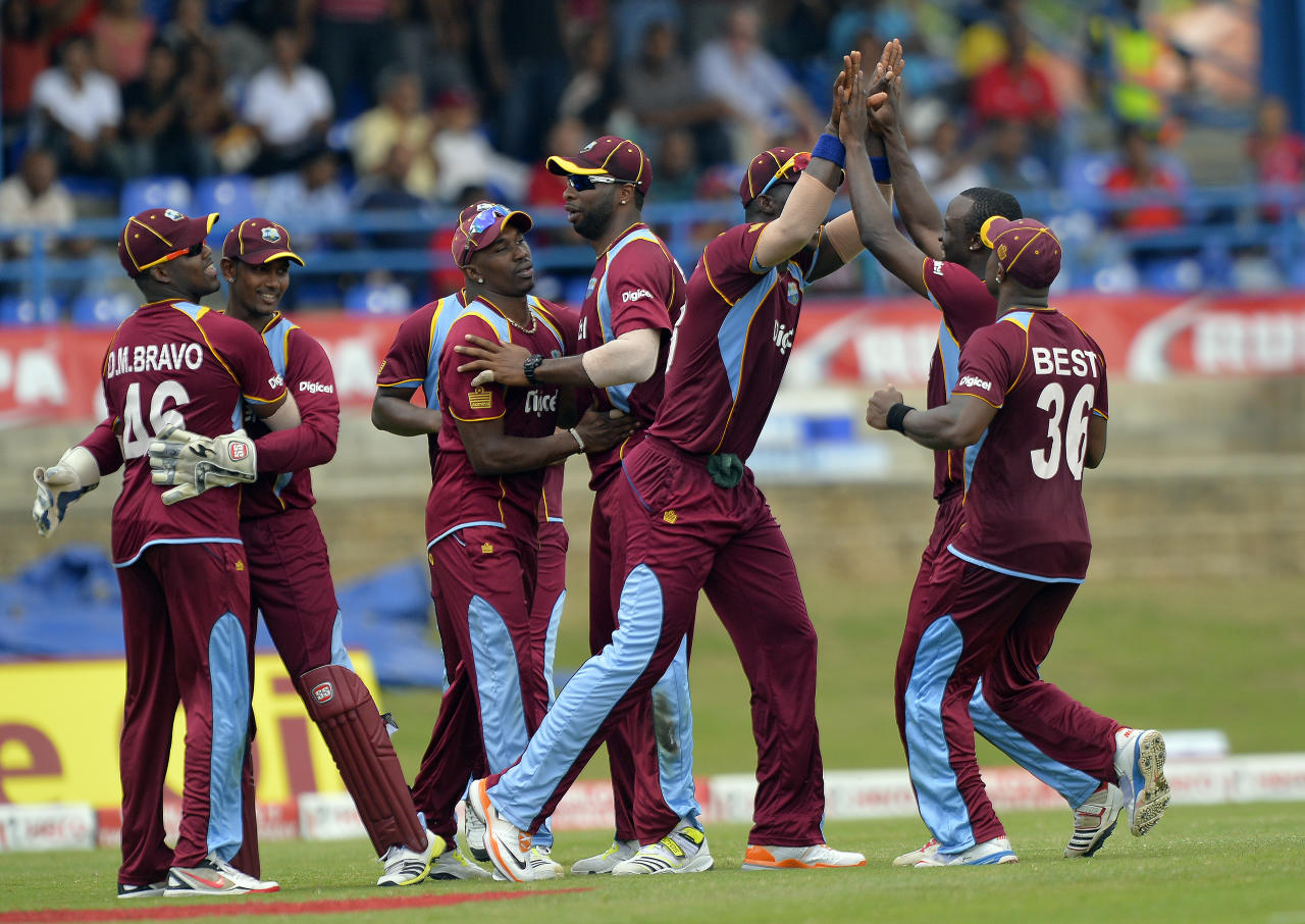 West Indies cricketer Kemar Roach (2nd-R) celebrates with teammates after dismissing Indian batsman Shikhar Dhawan during the fourth match of the Tri-Nation series between India and West Indies at the Queen's Park Oval in Port of Spain on July 5, 2013. West Indies won the toss and elected to field. AFP PHOTO/Jewel Samad        (Photo credit should read JEWEL SAMAD/AFP/Getty Images)