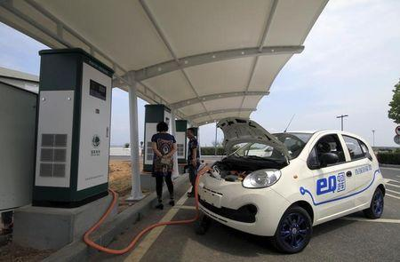 A Chery electric car is being charged at a charging station in Dalian