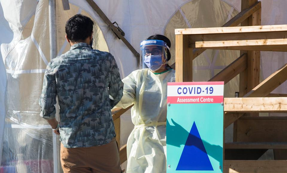 TORONTO, Nov. 8, 2020 -- A medical worker wearing protective gear talks to a man outside a COVID-19 assessment center in Toronto, Canada, on Nov. 8, 2020. Canada reported a total of 264,045 cases of COVID-19 and 10,522 deaths as of Sunday afternoon, according to CTV. (Photo by Zou Zheng/Xinhua via Getty) (Xinhua/Zou Zheng via Getty Images)
