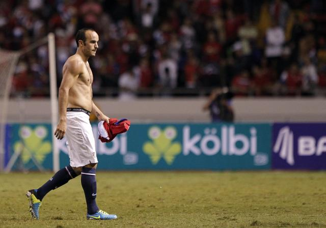 Donovan of the U.S. leaves the field after losing their 2014 World Cup qualifying soccer match against Costa Rica in San Jose
