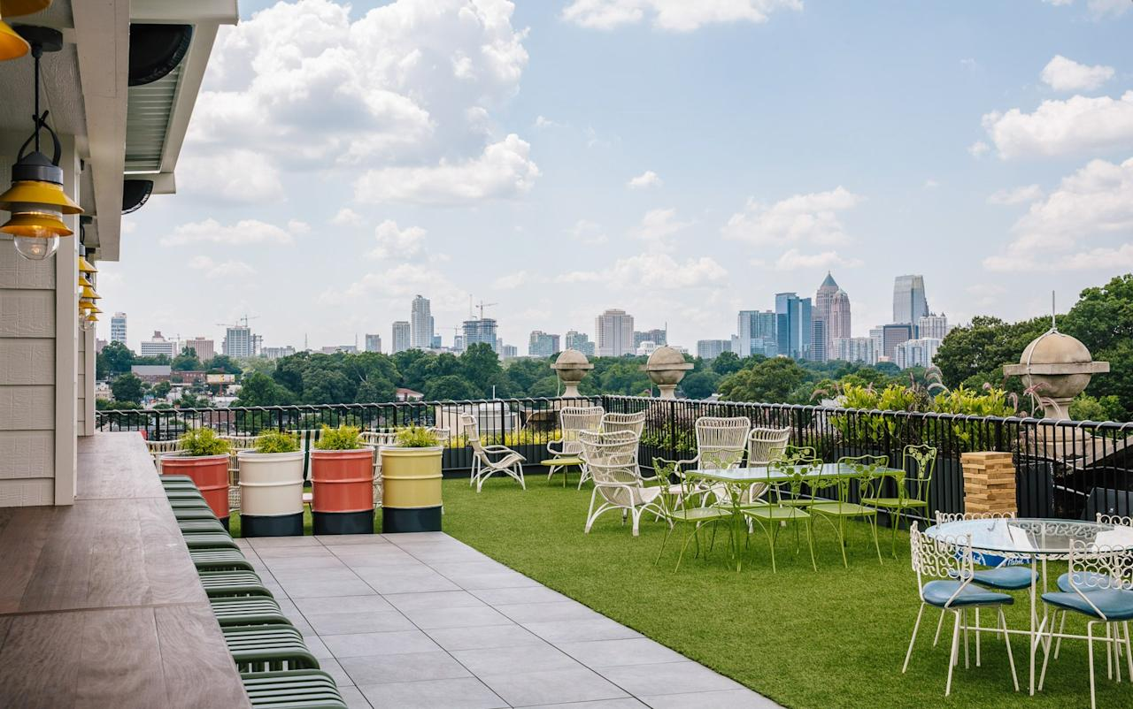 <p><strong>What's the vibe here?</strong><br> Hotel Clermont, a former motor lodge, is one of Atlanta's buzziest new boutique hotels. Ride the elevator to the fifth-floor and you'll find yourself at The Roof Top, a retro Astro Turf paradise with outdoor furniture, string lights, and lawn games (corn hole, anyone?), all against a backdrop of skyline views.</p> <p><strong>Who's there?</strong><br> On any given day (or night) you might find bros celebrating a bachelor party, corporate types with expense accounts, girls-night-out groups, and locals embracing their inner tourists. While the mostly tiki-inspired cocktails are well made, the Clermont's draw is as much about vibe as it is about the drinks themselves.</p> <p><strong>How are the drinks?</strong><br> The cocktails are mostly tiki-inspired; flavors like cherry, coconut, pineapple, and spicy falernum are used to create boozy drinks, including a frozen option or two. Beer drinkers will find a few local brews.</p> <p><strong>Anything good to eat, too?</strong><br> On Friday and Saturday nights (in every season but winter), you'll find a kitschy food cart offering gourmet hot dogs, burgers, and crepes. The bar has also introduced guest-chef food-cart pop-ups every now and then. If you're hungry for something more or find yourself here on weeknight, head down to the hotel's dimly lit Lobby Bar, where a menu includes steak frites and poutine.</p> <p><strong>How's the service?</strong><br> This is one of the most popular cocktail spots in town, so bartenders and servers tend to be busy. They'd prefer to answer your questions, take your order, deliver your order, and move on without any superfluous chit chat.</p> <p><strong>So why would you recommend this bar, and who for?</strong><br> Atlantans are really proud of The Hotel Clermont, both because it's a cool spot and because it represents the restoration of a nearly condemned 1924 building with a rich history. It's a great place for a casual date or get-together among friends, thanks to its playful retro vibe and terrific skyline views down Ponce de Leon. The bar can get busy and loud during peak times, so don't come expecting quiet conversation.</p>