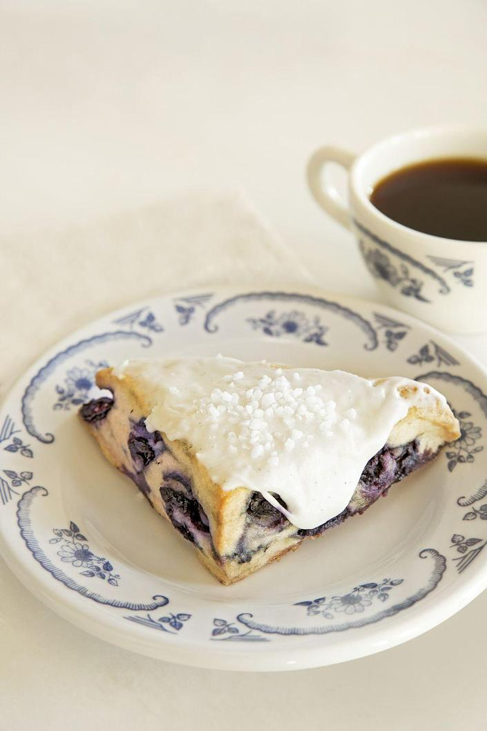 """<p>Ree has been serving these delicious scones at <a href=""""https://www.thepioneerwoman.com/ree-drummond-life/a32099921/ree-drummond-mercantile-store-restaurant-menu-info/"""" rel=""""nofollow noopener"""" target=""""_blank"""" data-ylk=""""slk:The Merc"""" class=""""link rapid-noclick-resp"""">The Merc</a> almost since it opened. They're <em>almost</em> too pretty to eat!</p><p><a href=""""https://www.thepioneerwoman.com/food-cooking/recipes/a35926348/blueberry-scones-with-vanilla-icing-recipe/"""" rel=""""nofollow noopener"""" target=""""_blank"""" data-ylk=""""slk:Get the recipe."""" class=""""link rapid-noclick-resp""""><strong>Get the recipe.</strong></a></p><p><a class=""""link rapid-noclick-resp"""" href=""""https://go.redirectingat.com?id=74968X1596630&url=https%3A%2F%2Fwww.walmart.com%2Fsearch%2F%3Fquery%3Dmixers&sref=https%3A%2F%2Fwww.thepioneerwoman.com%2Ffood-cooking%2Frecipes%2Fg36145857%2Fbreakfast-in-bed-recipes%2F"""" rel=""""nofollow noopener"""" target=""""_blank"""" data-ylk=""""slk:SHOP MIXERS"""">SHOP MIXERS</a></p>"""