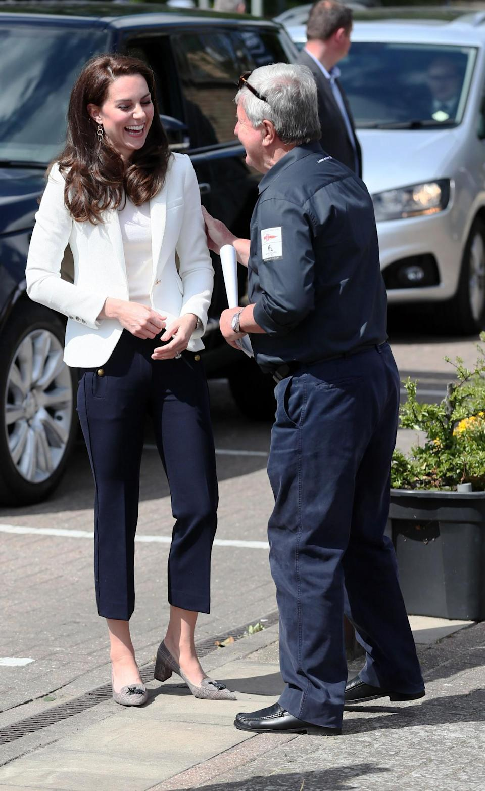 <p>Kate went for a nautical look to visit the 1851 Trust. She chose cropped navy sailor trousers by J. Crew and a fitted white blazer from high street retailer Zara. The Duchess also chose J. Crew for her shoes, wearing a low-heeled tweed pair.<br><i>[Photo: PA]</i> </p>