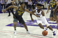 Baylor guard Jared Butler (12) defends as TCU guard Mike Miles (1) tries to drive past in the first half of an NCAA college basketball game, Saturday, Jan. 9, 2021, in Fort Worth, Texas. (AP Photo/ Richard W. Rodriguez)