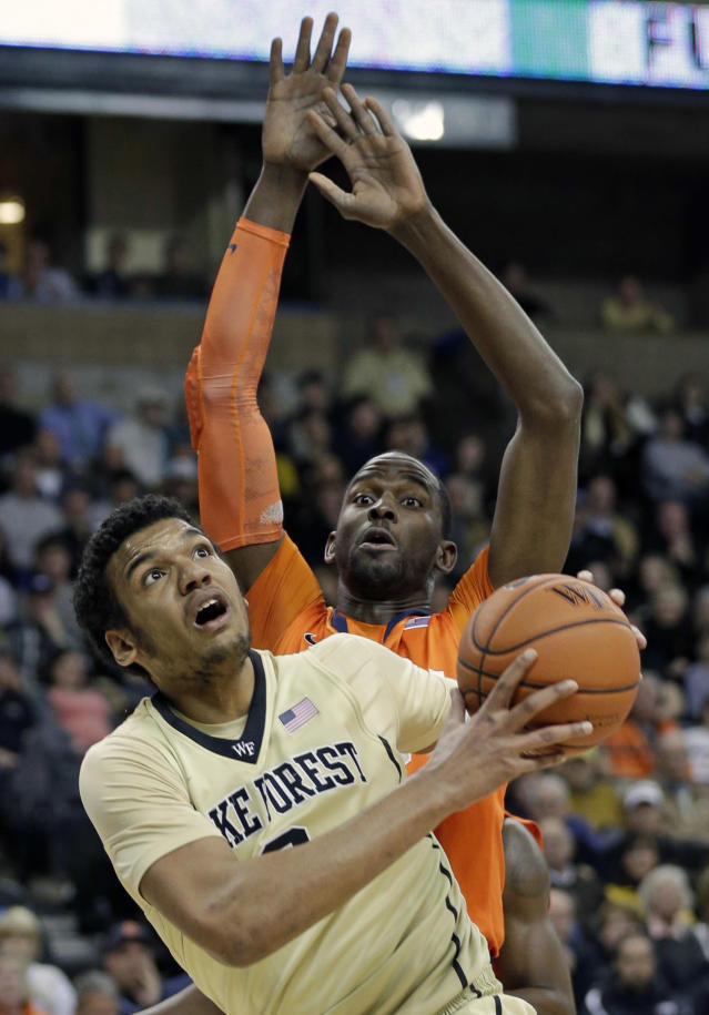 Wake Forest's Devin Thomas, front, drives to the basket against Syracuse's Baye Moussa Keita, back, during the first half of an NCAA college basketball game in Winston-Salem, N.C., Wednesday, Jan. 29, 2014. (AP Photo/Chuck Burton)