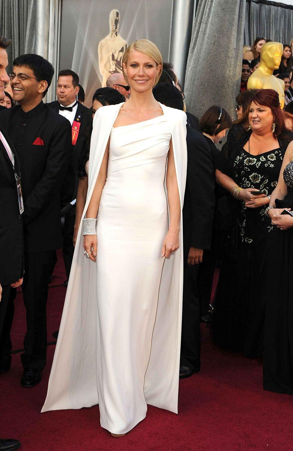 <p>Gwyneth Paltrow in a modern Tom Ford gown and cape.</p>