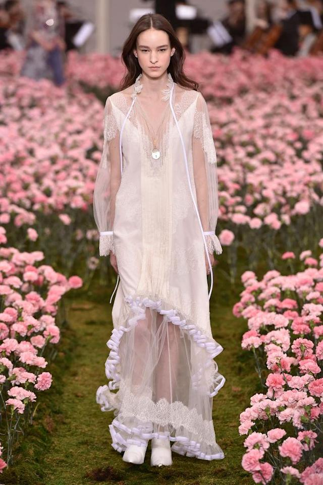 <p>A sheer white, ruffled-hem dress from the Tory Burch FW18 show. (Photo: Getty) </p>