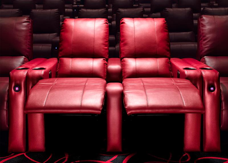 Red leather reclining seats at an AMC Theatre cinema.