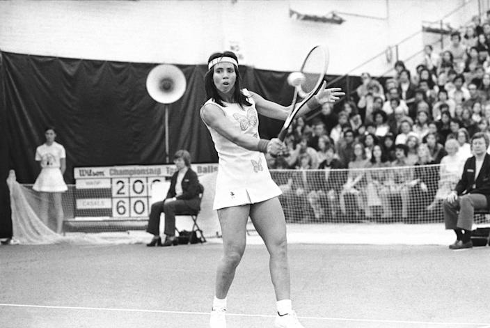 Rosie Casals returns shot by Virginia Wade during a Virginia Slims event on March 3, 1974, in Chicago.