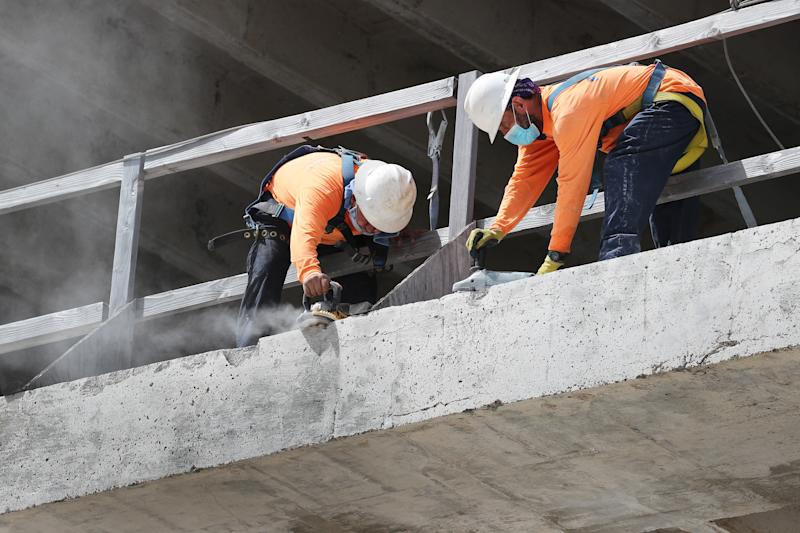 MIAMI, FLORIDA - SEPTEMBER 04: Construction workers are seen on a job site on September 04, 2020 in Miami, Florida. The Bureau of Labor Statistics released a report today that shows the unemployment rate fell to 8.4 percent last month, down from a COVID-19 pandemic peak of 14.7 percent in April. (Photo by Joe Raedle/Getty Images)