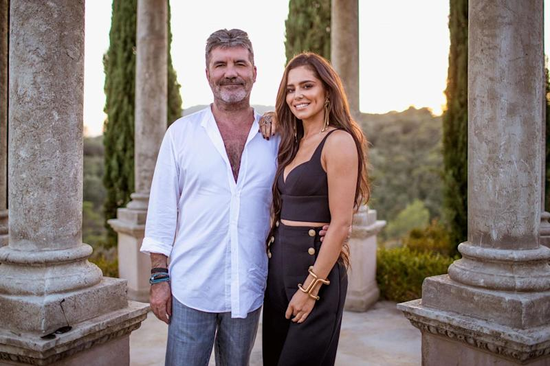 Cheryl: The former singer posed with Simon Cowell for the Judges' Houses episode: Rex Features