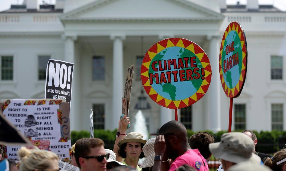 "<span class=""element-image__caption"">Protesters carry signs during the People's Climate March at the White House in Washington.</span> <span class=""element-image__credit"">Photograph: Joshua Roberts/Reuters</span>"