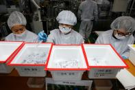 Employees work at a low dead space (LDS) syringe factory in Gunsan