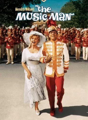 """<p>The 1962 movie <em>The Music Man</em> tells the story of Harold Hill, a con man who poses as a band leader to try and steal money from an Iowa town. In addition to a cheery 4th of July scene, the movie also features one of the most memorable on-screen parades in movie history. </p><p><a class=""""link rapid-noclick-resp"""" href=""""https://www.amazon.com/Music-Man-Robert-Preston/dp/B0093Q9YNQ/ref=sr_1_2?tag=syn-yahoo-20&ascsubtag=%5Bartid%7C10070.g.36156094%5Bsrc%7Cyahoo-us"""" rel=""""nofollow noopener"""" target=""""_blank"""" data-ylk=""""slk:STREAM NOW"""">STREAM NOW</a></p>"""