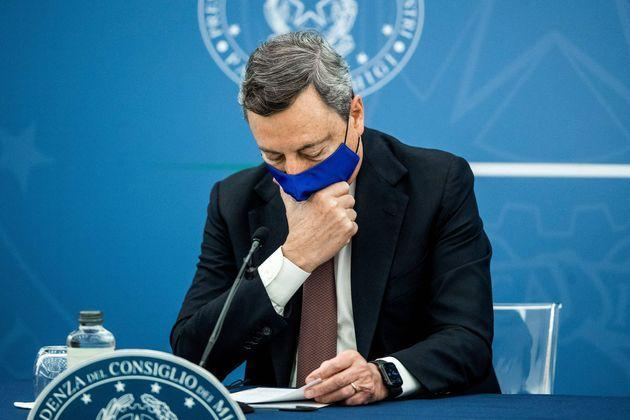 TOPSHOT - Italian Prime Minister Mario Draghi touches his face mask during a press conference with Italy's Justice Minister and Italy's Health Minister (unseen) at the Multifunctional Hall of the Presidency of the Council, in Rome, on July 22, 2021. (Photo by Roberto MONALDO / POOL / AFP) (Photo by ROBERTO MONALDO/POOL/AFP via Getty Images) (Photo: ROBERTO MONALDO via Getty Images)