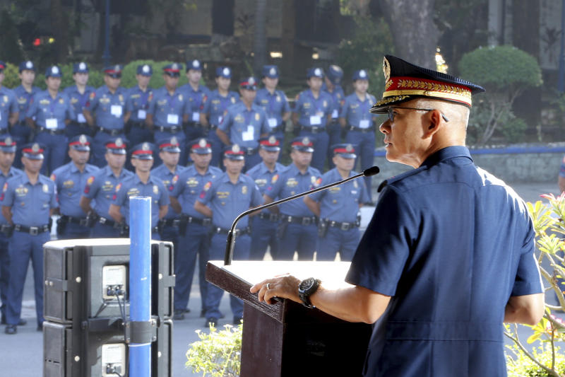 In this photo provided by Philippine National Police Public Information Office, Philippine National Police chief Gen. Oscar Albayalde addresses hundreds of police officers during the flag-raising ceremony at Camp Crame Monday, Oct. 14, 2019 in suburban Quezon city, northeast of Manila, Philippines. Albayalde resigned on Monday after he faced allegations in a Senate hearing that he intervened as a provincial police chief in 2013 to prevent his officers from being prosecuted for allegedly selling a huge quantity of illegal drugs they had seized. (Philippine National Police via AP)