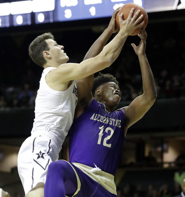 Vanderbilt forward Yanni Wetzell, left, fights Alcorn State forward DeShaw Andrews (12) for a rebound in the first half of an NCAA college basketball game Friday, Nov. 16, 2018, in Nashville, Tenn. (AP Photo/Mark Humphrey)