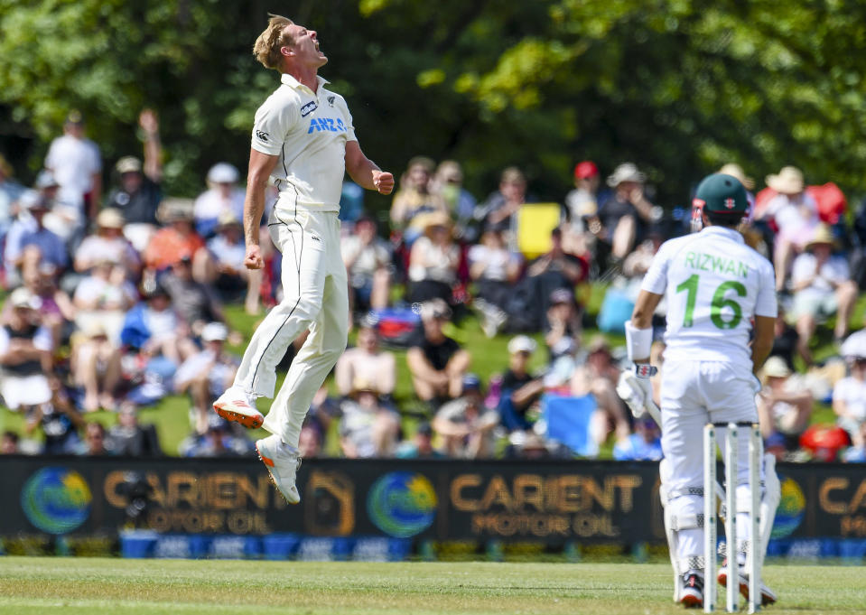 New Zealand bowler Kyle Jamieson, left, celebrates the wicket of Pakistan batsman Mohammad Rizwan during play on the first day of the second cricket test between Pakistan and New Zealand at Hagley Oval, Christchurch, New Zealand, Sunday, Jan 3. 2021. (John Davidson/Photosport via AP)