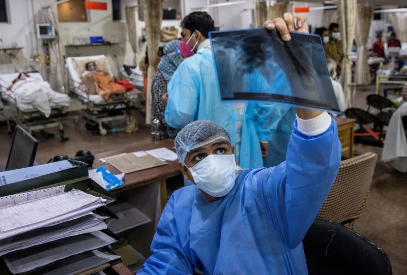 The Wider Image: As COVID ravages India, a 26-year-old doctor decides who lives and who dies
