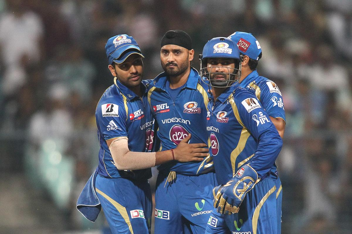 Harbhajan Singh of Mumbai Indians is congratulated by Mumbai Indians captain Rohit Sharma and Dinesh Karthik of Mumbai Indians after getting Ajinkya Rahane of Rajasthan Royals wicket during the 2nd Qualifying match of the Pepsi Indian Premier League between The Rajasthan Royals and the Mumbai Indians  held at the Eden Gardens Stadium in Kolkata on the 24th May 2013..Photo by Shaun Roy-IPL-SPORTZPICS    ..Use of this image is subject to the terms and conditions as outlined by the BCCI. These terms can be found by following this link:..https://ec.yimg.com/ec?url=http%3a%2f%2fwww.sportzpics.co.za%2fimage%2fI0000SoRagM2cIEc&t=1493606591&sig=FOreTsKbdj69JsRZNT2_4Q--~C