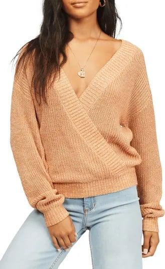 <p>Instead of a standard v-neck, pick this <span>Billabong Bring It Faux Wrap Sweater</span> ($40-$56) when you want to slouch shoulders off the neck with a plunging neckline, too.</p>