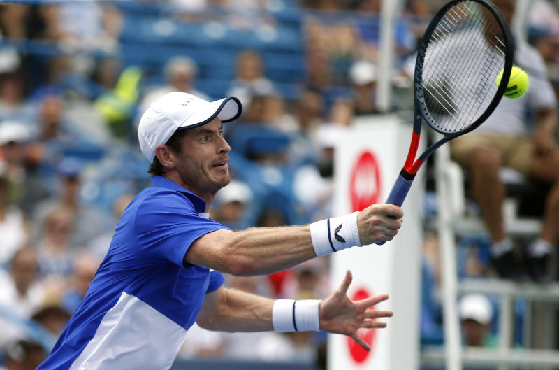 Andy Murray, of Britain, hits a forehand volley against Richard Gasquet, of France, during first-round play at the Western & Southern Open tennis tournament Monday, Aug. 12, 2019, in Mason, Ohio. (AP Photo/Gary Landers)