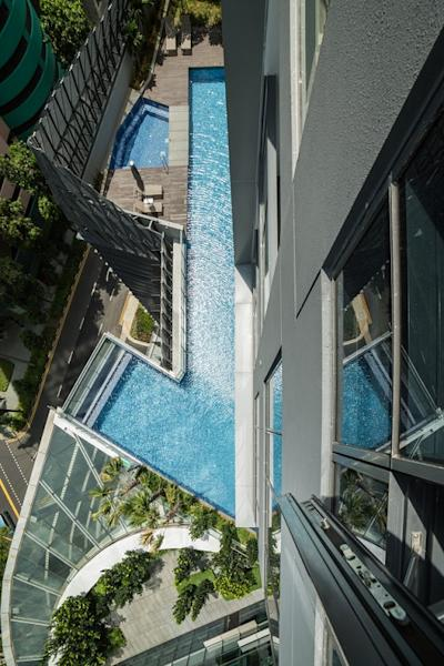 Aerial view of the swimming pool on the ground level of the condo project