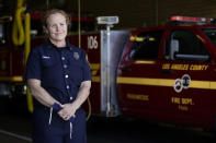 Fire Truck Captain Jeane Barrett of Los Angeles County Fire Department - Station 106 poses for a photo at her station Friday, Feb. 26, 2021, in Rancho Palos Verdes, Calif, a suburb of Los Angeles. She was among first responders at the scene of a vehicle crash involving golfer Tiger Woods on Tuesday. (AP Photo/Ashley Landis)
