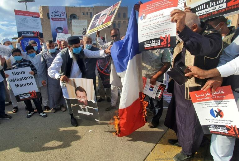 In the Libyan capital protesters trampled a French flag and torched it