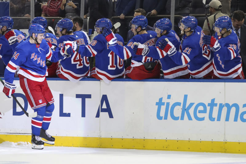 New York Rangers right wing Kaapo Kakko (24) celebrates at the bench after scoring a goal against the Edmonton Oilers during the first period of an NHL hockey game, Saturday, Oct. 12, 2019, at Madison Square Garden in New York. (AP Photo/Mary Altaffer)