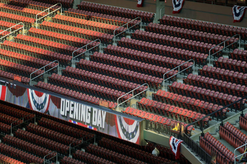 Empty seats are seen in Busch Stadium before the start of an opening day baseball game for the St. Louis Cardinals and Pittsburgh Pirates Friday, July 24, 2020, in St. Louis. (AP Photo/Jeff Roberson)