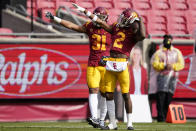 Southern California linebacker Hunter Echols (31) and cornerback Olaijah Griffin (2) celebrate after they thought they recovered a fumble against Arizona State during the first half of an NCAA football game Saturday, Nov. 7, 2020, in Los Angeles. Arizona offense recovered the fumble and there was no turnover. (AP Photo/Ashley Landis)