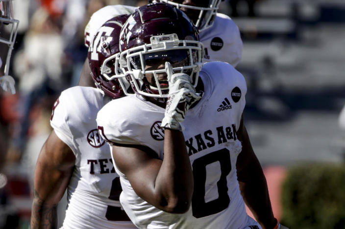 Texas A&M running back Ainias Smith (0) reacts after scoring a touchdown against Auburn during the second half of an NCAA college football game on Saturday, Dec. 5, 2020, in Auburn, Ala. (AP Photo/Butch Dill)