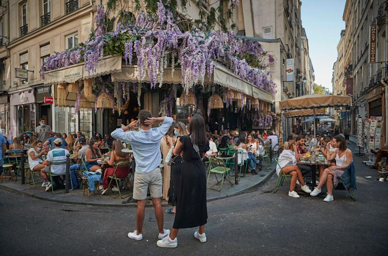 A packed cafe in Paris as Europe faces a second wave of coronavirus infections.