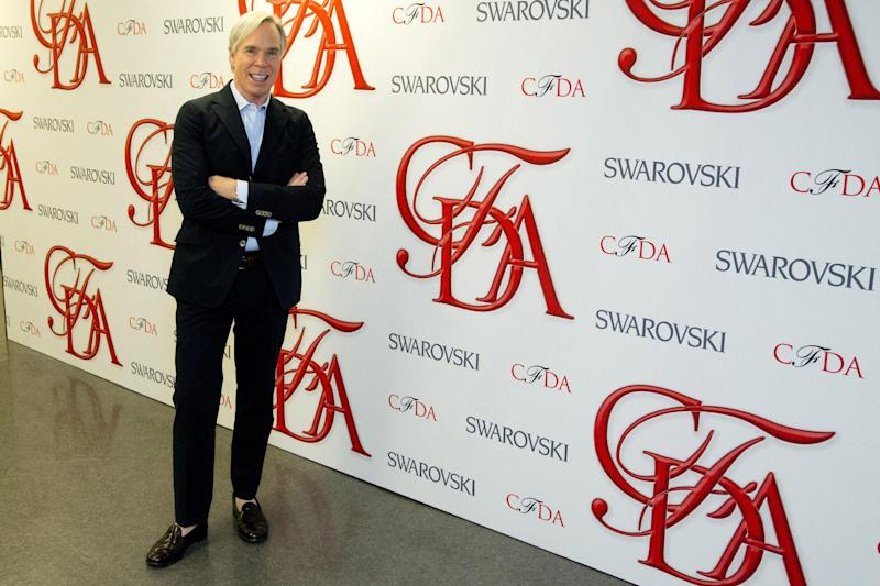 """This June 4, 2012 photo shows Tommy Hilfiger at rehearsals for the CFDA Awards in New York. Hilfiger has been in the fashion business for more than 40 years, starting at a little denim shop in Elmira, N.Y., and now at the helm of a brand that's one of the most recognizable in the world. This spring, he added """"American Idol"""" style adviser to his resume. His peers at the Council of Fashion Designers of America honored him Monday night with a lifetime achievement award. (AP Photo/Charles Sykes)"""
