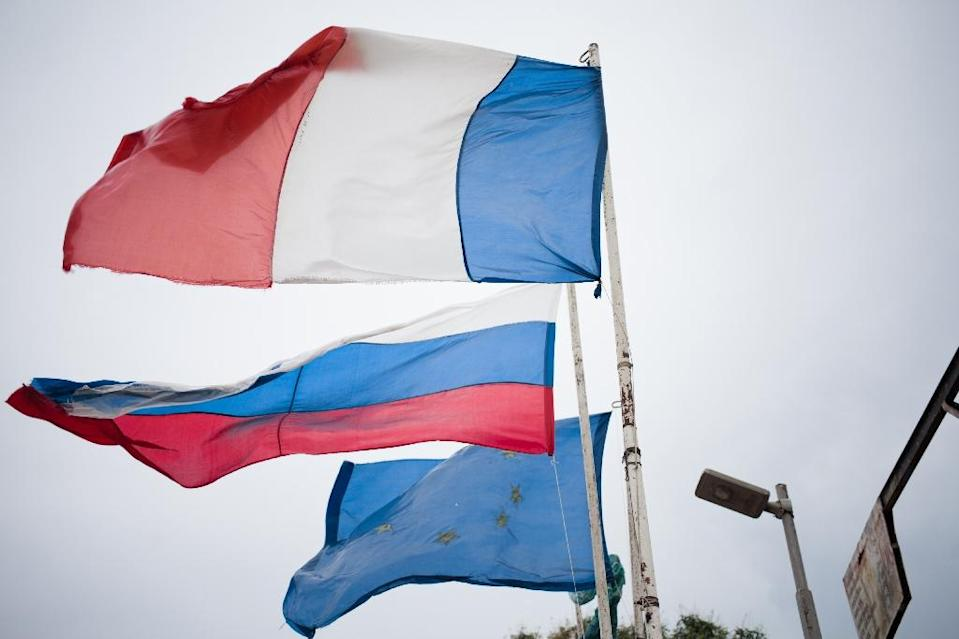 Russian, EU and French flags are seen at the entrance to the village of Pissa, not far from Berengo Palace, the former palace of the president Jean-Bedel Bokassa, which has been transformed into a military training camp (AFP Photo/FLORENT VERGNES)