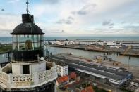 The ferry terminal is seen behind the top of lighthouse in Calais
